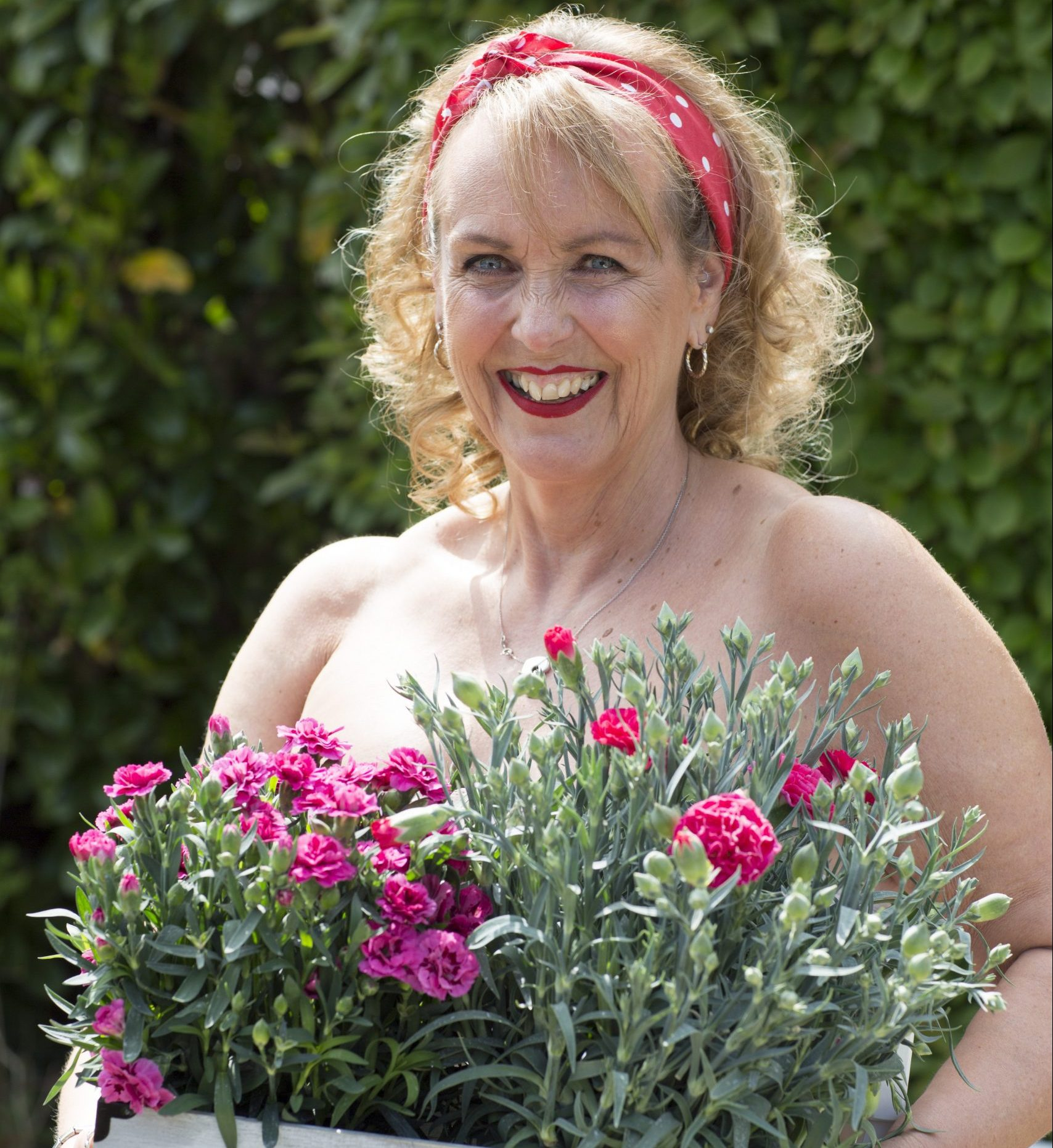 Jo during our calendar shoot, posing with flowers.